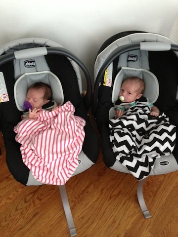 Emma and Kate ready to go in their car seats  twins